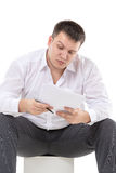 Businessman reading a report with scepticism Stock Photos