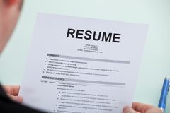 Businessman Reading Resume At Office Desk Royalty Free Stock Photo