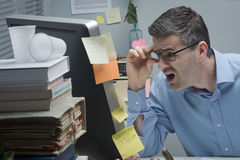 Businessman reading shocking news online Stock Images