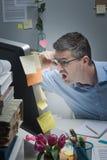Businessman reading shocking news online Royalty Free Stock Photography