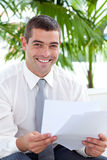 Businessman reading some documents Stock Image