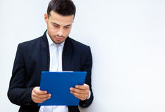 Businessman reading some documents Royalty Free Stock Photography