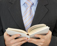 Businessman reading statute book Royalty Free Stock Photo