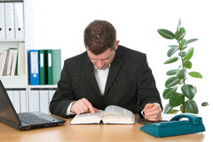 Businessman is reading Royalty Free Stock Image