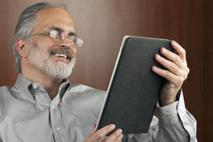 Businessman Reading From a Tablet stock images