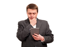 Businessman reading a tablet Royalty Free Stock Image