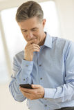 Businessman Reading Text Message On Mobile Phone Royalty Free Stock Photo