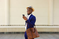 Businessman reading text message on mobile phone Stock Photos
