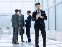 Businessman reading text message on smartphone Royalty Free Stock Photos