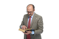 The businessman reads the book Royalty Free Stock Images