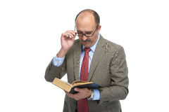 The businessman reads the book Stock Photography