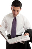 Businessman Reads Share Prices In Newspaper Stock Image