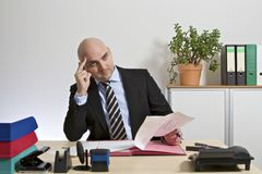 Businessman reads thoughtfully a document Stock Photo