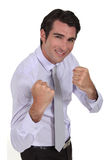 Businessman ready for fight. Smiling businessman ready for fight Royalty Free Stock Photography