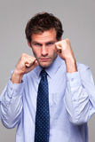 Businessman ready to do battle. Businessman in shirt and tie with his fists raised ready for a fight Stock Photo