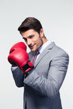 Businessman ready to fight with boxing gloves Stock Photo