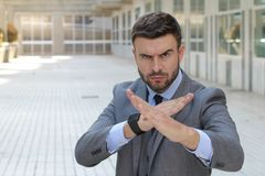 Businessman ready to fight in office space stock images