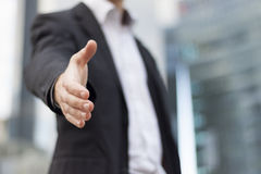 Businessman ready to handshake. Businessman with an open hand ready to seal a deal Stock Photography