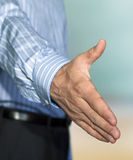 Businessman ready to make a deal. Businessman giving a hand ready to make a deal with you Royalty Free Stock Photo