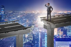 The businessman ready to overcome the broken bridge Stock Image