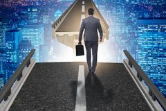 The businessman ready to overcome the broken bridge Stock Images