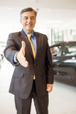 Businessman ready to shake hand Stock Image