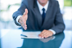 Businessman ready to shake hand Stock Photos