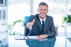 Businessman ready to shake hand Stock Photography