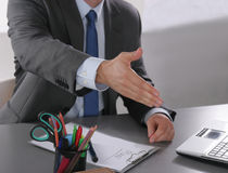 Businessman ready to shake hand in office Royalty Free Stock Images