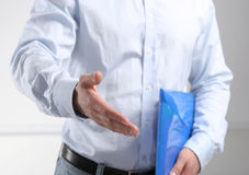 Businessman ready to shake hand in office Royalty Free Stock Photo