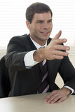 Businessman ready to shake hands Stock Photos