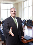 Businessman ready to shake hands royalty free stock photo