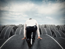 Businessman ready to start on complicated roads. Businessman ready to start on complicated multiple roads. Concept of determination, confusion, decision Royalty Free Stock Photo