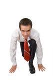 Businessman ready to start running. Isolated Stock Photo