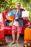 Businessman ready to trip Royalty Free Stock Image