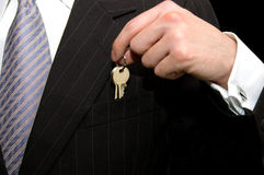 Businessman - real estate concept. Real estate concept, Man saving his new department key into his pocket Stock Photography