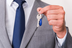 The businessman in real estate concept with home key Stock Photography