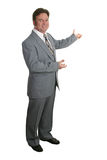 Businessman Or Realtor Complete 3. A businessman or realtor gesturing with both hands toward a chart or home - isolated Royalty Free Stock Photo