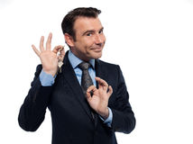 Businessman realtor teasing holding offering keys Royalty Free Stock Photo
