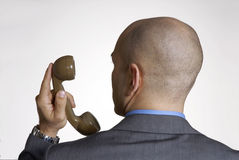 Businessman. Rear view from annoying bald head man on phone stock photo