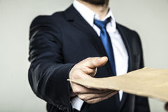 Businessman received an envelope with a bribe. Business man received an envelope with a bribe Royalty Free Stock Photography