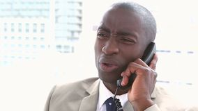 Businessman receiving a bad news by phone Stock Photography