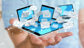 Businessman receiving e-mails on his digital devices 3D renderin Royalty Free Stock Images