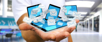 Businessman receiving e-mails on his digital devices 3D renderin Stock Photo
