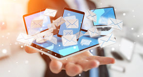 Businessman receiving e-mails on his digital devices 3D renderin Stock Photos