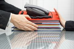 Businessman is receiving files and telephone Stock Image