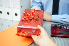 Businessman is receiving a gift from partner Stock Images