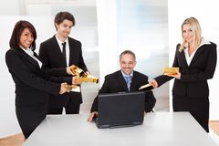 Businessman receiving gold bars Stock Photo