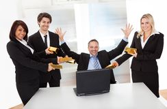 Businessman receiving gold bars Stock Photos