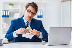 The businessman receiving his salary and bonus. Businessman receiving his salary and bonus royalty free stock photography